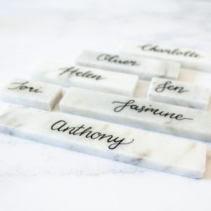 natural marble place setting with black ink calligraphy